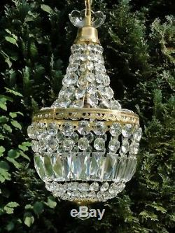 Here is a Very Fine Vintage French Crystal, 10 Brass Empire Bag Chandelier